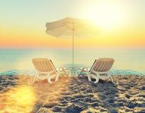 Beach chair and white umbrella on beach Stock Photo