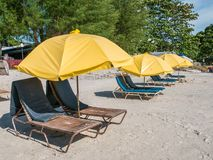 Beach Chair with Yellow Umbrella in the Beach. Beach Chair with Yellow Umbrella with No People in Cenang Beach Langkawi, Malaysia stock photography