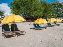 Beach Chair with Yellow Umbrella in the Beach. Beach Chair with Yellow Umbrella with No People in Cenang Beach Langkawi Malaysia royalty free stock images