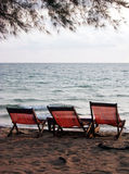 Beach chairs. 3 beach chairs at a tropical beach royalty free stock photography
