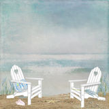 Adirondack chairs on ocean seashore Royalty Free Stock Images