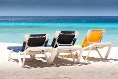 Beach chairs. On sandy tropical beach Royalty Free Stock Photos