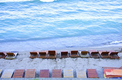 Beach chairs. Beach lounge chairs on the sea shore Stock Photography