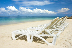 Beach with chairs Royalty Free Stock Photo