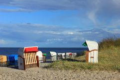 Beach chairs. In the sand dunes on the North Sea, Germany Royalty Free Stock Photos