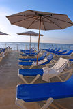 Beach Chairs. Line of inviting beach chairs on the ocean Royalty Free Stock Photos