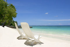 Beach chairs. Two empty beach chairs. Coast of Indian ocean. Maldives stock image