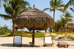 Beach chairs. And a sun umbrella. Mozambique beach resort, Africa Royalty Free Stock Image