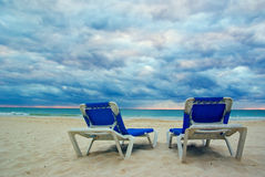 Beach Chairs. Empty chair sitting on a empty beach resort Royalty Free Stock Photography