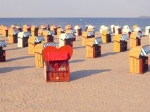 Beach chairs. Roofed wicker beach chairs Stock Photos