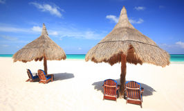 Free Beach Chairs And Thatched Palapa Umbrellas At Reso Royalty Free Stock Photography - 12435027