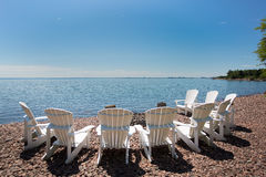 Beach chairs arranged in a semicircle on the shore of Lake Super Royalty Free Stock Images