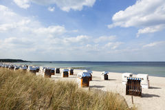 Beach chairs at the baltic sea. Beach chairs, so-called Strandkorbs, at Timmendorfer Strand on the german baltic sea shore Royalty Free Stock Photo