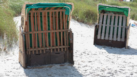 Beach chairs on the baltic sea waiting to be rent Royalty Free Stock Image