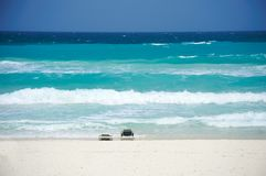 Beach chairs on the beach. Facing Cancun's Caribbean Sea Stock Photo