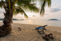 Beach chairs on beach. With beautiful beach and tropical sea at sunset Royalty Free Stock Photography