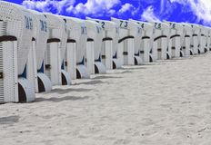 Beach chairs on the beach. With a blue sky with white clouds above the beach Royalty Free Stock Image