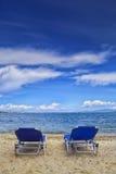 Beach chairs on the beach. Beach chairs on sand beach with cloudy blue sky royalty free stock photos