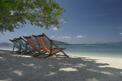 Beach chairs at beautiful beach Stock Photo