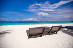 Beach Chairs on beautiful island in white sand Royalty Free Stock Photos
