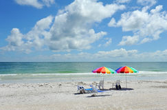 Beach Chairs with Bright Color Umbrellas Royalty Free Stock Image