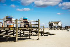 Beach chairs and buildings of St. Peter-Ording, Germany Royalty Free Stock Images