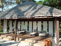 Beach chairs and cabana Stock Photos