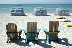 Beach chairs and cabanas Stock Image