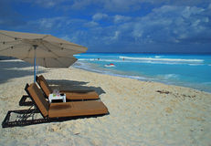 Beach and chairs in Cancun, Mexico Royalty Free Stock Photography