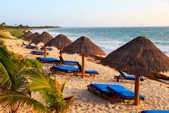 Beach chairs on carribean coast Royalty Free Stock Photos