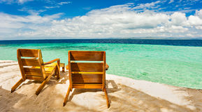 Beach chairs, clear water and beautiful view on tropical island, Royalty Free Stock Photo