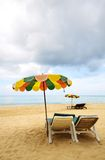 Beach chairs and colorful umbrella Royalty Free Stock Photo
