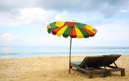 Beach chairs and colorful umbrella Royalty Free Stock Image