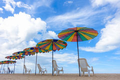 Beach chairs with colorful umbrella at the beach Stock Image