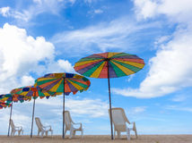 Beach chairs with colorful umbrella at the beach Stock Photo