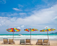Beach chairs and colorful umbrella on the beach at Phuket Thaila Stock Images