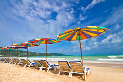 Beach chairs and colorful umbrella on the beach Stock Photography