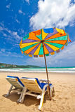 Beach chairs and colorful umbrella on the beach, Phuket Thailand Stock Photo