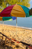 Beach chairs and colorful umbrellas on the beach in sunny day, T Royalty Free Stock Image