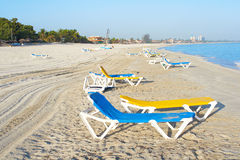Beach chairs in a deserted beach. View of a deserted beach Royalty Free Stock Photography