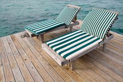Beach Chairs on Dock. Two Beach Chairs on a Dock Overlooking the Ocean stock images