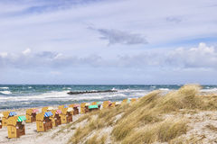 Beach chairs with dunes at Wustrow Stock Photo