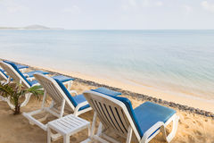 Beach chairs at an empty beach in Thailand Royalty Free Stock Images