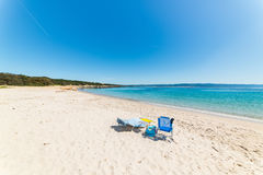 Beach chairs on a empty beach. Under a clear sky stock photography