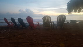 Beach chairs. Empty beach chairs overlooking the sunset Royalty Free Stock Image