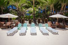 Beach chairs in exotic resort on perfect white Royalty Free Stock Photo
