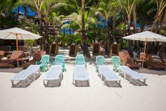 Beach chairs in exotic resort on perfect white Royalty Free Stock Image