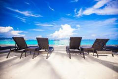 Beach chairs in exotic resort on perfect white Stock Photo