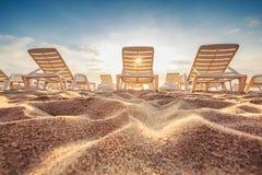 Beach chairs on the exotic tropical beach, sunrise shot Stock Photo