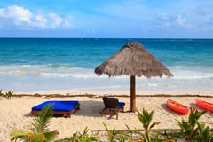 Beach chairs on exotic tropical sand beach Stock Image